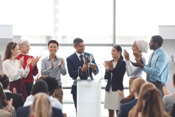 Businessman-receiving-award-employee-recognition