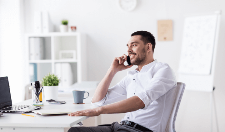 man in home office on phone