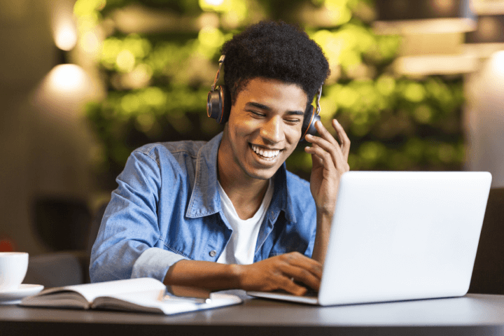 man on video call on laptop with headphones