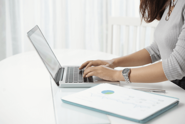 microsoft teams vs slack - woman using laptop