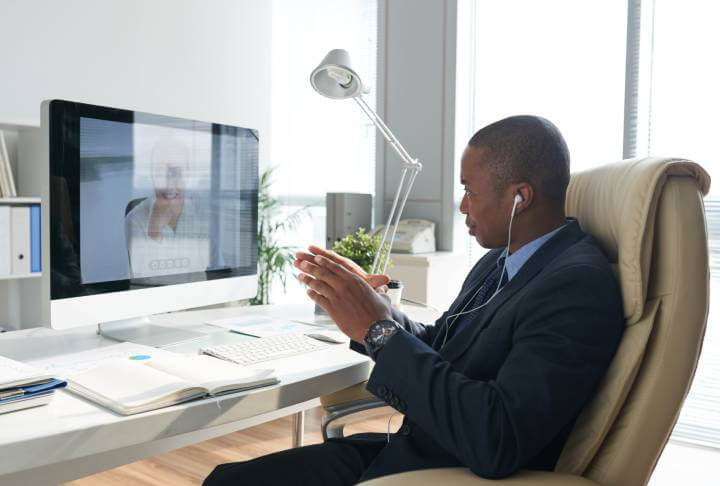 man on video call in his office
