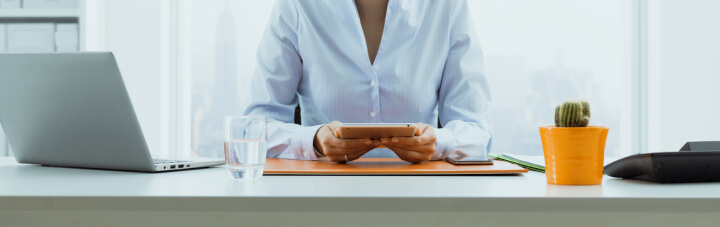 Woman on tablet at desk